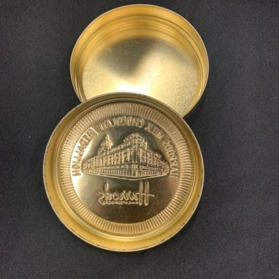 Harris's collectable GOLD round tin