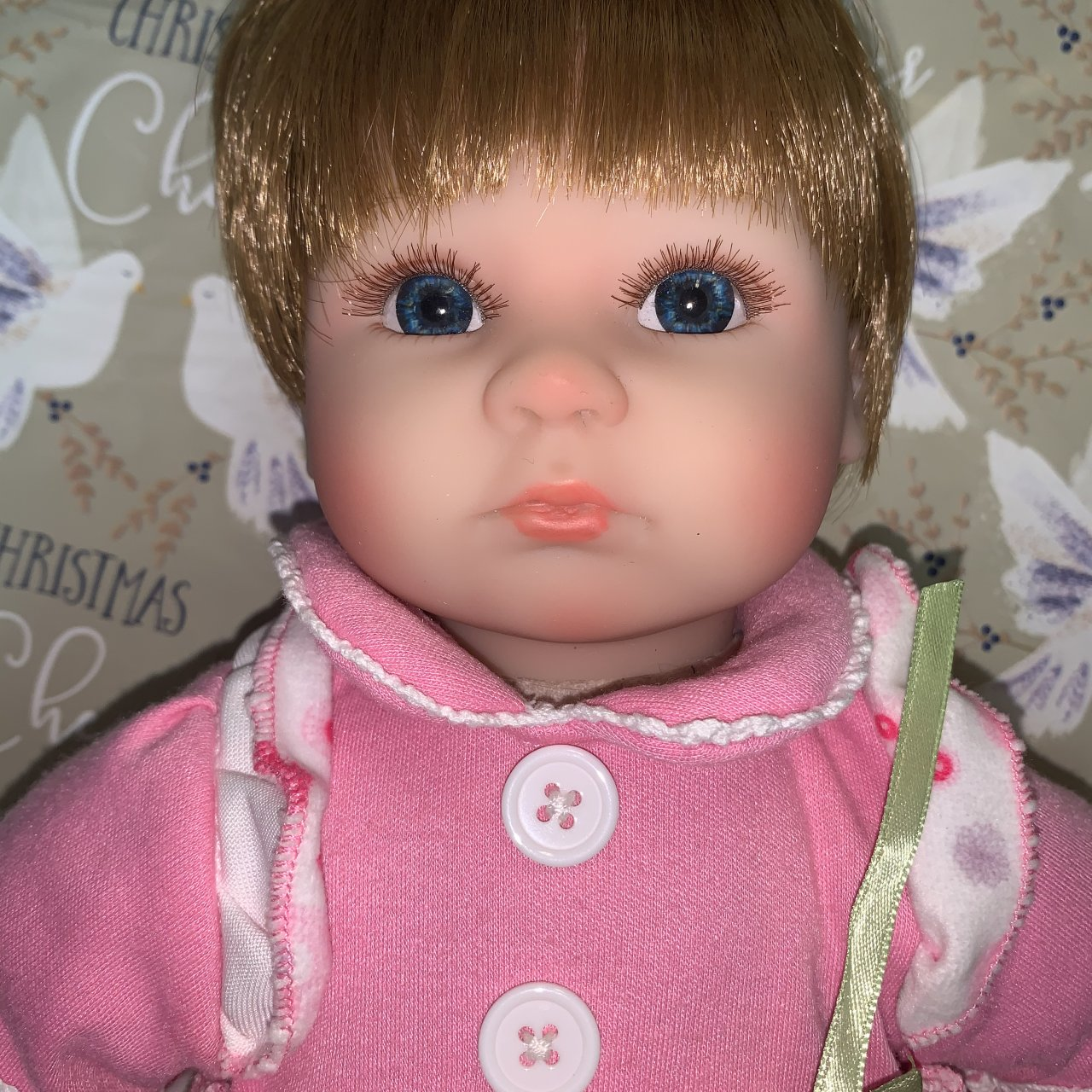 Female baby doll figurine in realistic style